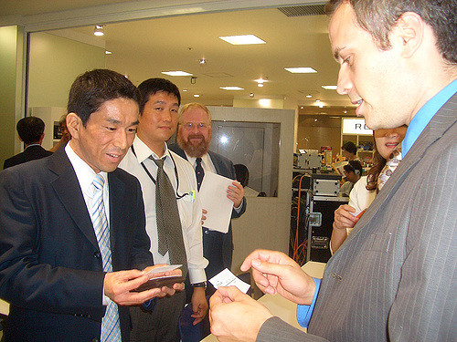 Exchanging business cards in Japanese meeting